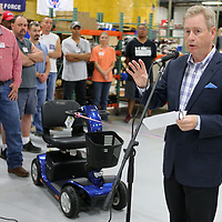 Dwight Hardison, Managing Director at Direct Mobility in Pontotoc, talks about the Victory 10 Scooter that is assembled at the Pontotoc plant during its unvieling Thursday.