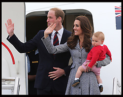 The Duke and Duchess of Cambridge and Prince George wave from the steps of their plane as they leave  Canberra airport in Australia at the end of their Royal Tour , Friday, 25th April 2014. Picture by Stephen Lock / i-Images