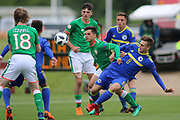 Alen Mehic of Bosnia and Herzegovina (8) tackles Sean Brennan of Republic of Ireland (11) during the UEFA European Under 17 Championship 2018 match between Bosnia and Republic of Ireland at Stadion Bilino Polje, Zenica, Bosnia and Herzegovina on 11 May 2018. Picture by Mick Haynes.