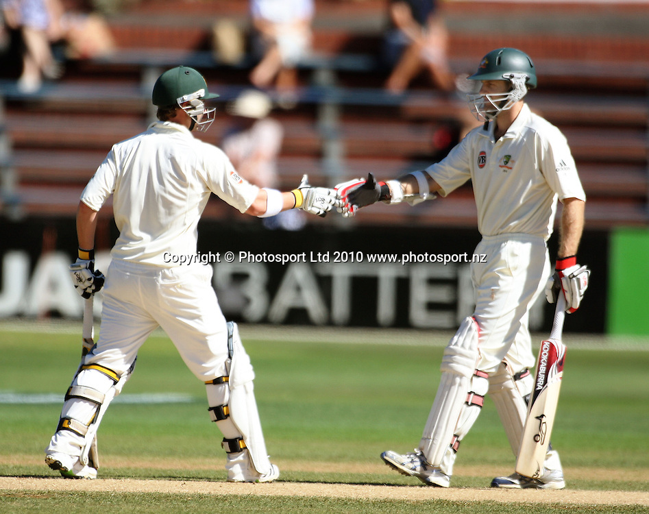 Australian batsman Simon Katich congratulates fellow opener Phil Hughes (left) on his 50.<br /> 1st cricket test match - New Zealand Black Caps v Australia, day five at the Basin Reserve, Wellington. Tuesday, 23 March 2010. Photo: Dave Lintott/PHOTOSPORT