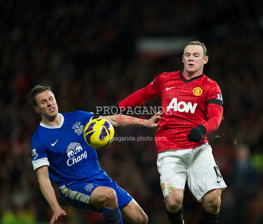 MANCHESTER, ENGLAND - Sunday, February 10, 2013: Manchester United's Wayne Rooney in action against Everton's Phil Jagielka during the Premiership match at Old Trafford. (Pic by David Rawcliffe/Propaganda)