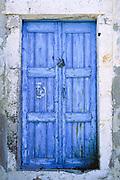 Locked wood door painted bright blue, on Santorini Island, Greece, Europe.