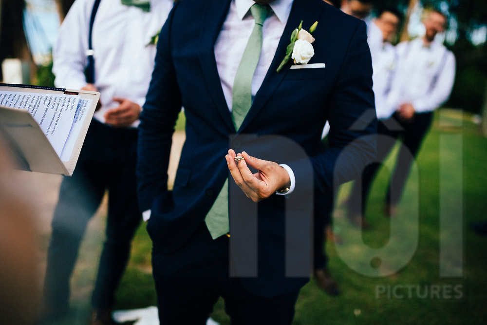 The groom holds his wedding ring during a ceremony, Ko Samui, Thailand, Southeast Asia