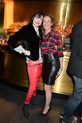 Left to right, JASMINE GUINNESS and LEAH WOOD at the Launch Of Osman Yousefzada's 'The Collective' 4th edition with special guest collaborator Poppy Delevingne held in the Rumpus Room at The Mondrian Hotel, 19 Upper Ground, London SE1 on 24th November 2014, sponsored by Storm models and Beluga vodka.