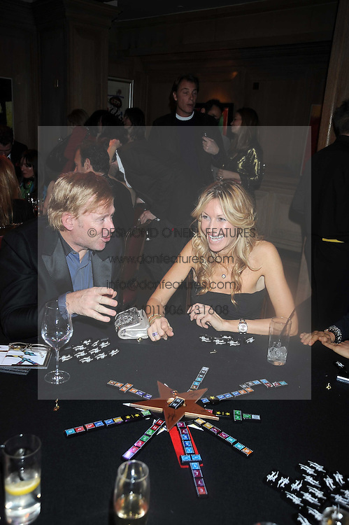 MELISSA ODABASH and DAVID COLLINS at a party to celebrate the launch of Hollywood Domino - a brand new board game, held at Mosimann's 11b West Halkin Street, London on 7th November 2008.  The evening was in aid of Charlize Theron's Africa Outreach Project.