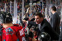 KELOWNA, CANADA - MARCH 16:  Kelowna Rockets' head coach Adam Foote goes over a play on the bench against the Vancouver Giants on March 16, 2019 at Prospera Place in Kelowna, British Columbia, Canada.  (Photo by Marissa Baecker/Shoot the Breeze)