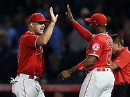 June 6, 2018 - Anaheim, CA, U.S. - ANAHEIM, CA - JUNE 06: Los Angeles Angels of Anaheim outfielders Mike Trout (27) and Justin Upton (8) on the field after the Angels defeated the Kansas City Royals 4 to 3 in a game played on June 6, 2018 at Angel Stadium of Anaheim in Anaheim, CA. (Photo by John Cordes/Icon Sportswire) (Credit Image: © John Cordes/Icon SMI via ZUMA Press)
