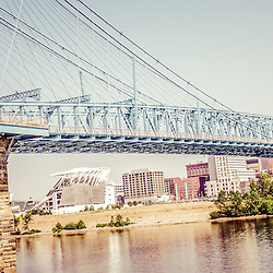 Cincinnati Bridge Retro Panorama Photo of John A. Roebling Bridge. The John A. Roebling Suspension Bridge was built in 1865 and crosses the Ohio River connecting Covington Kentucky with Cincinnati Ohio. Panoramic photo ratio is 1:3.