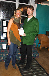 ANNA COVERDALE and ADAM JACOT DE BOINOD at a party to celebrate the publicarion of The Meaning of Tingo by Adam Jacot de Boinod held at the Daunt Bookshop, 83 Marylebone High Street, London on 18th October 2005.<br />