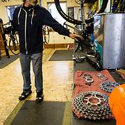 Micheal Woodruffworks on a bike in the maintenance shop of Fitzgerald's Bike Shop.