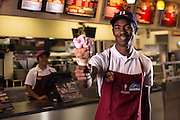 A server handing over an ice cream cone from Braum's Ice Cream and Dairy stores.