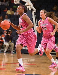 Virginia forward Monica Wright (22) dribbles up court against Miami.  The #21 ranked Virginia Cavaliers defeated the Miami Hurricanes 85-74 in overtime at the John Paul Jones Arena in Charlottesville, VA on February 19, 2009.