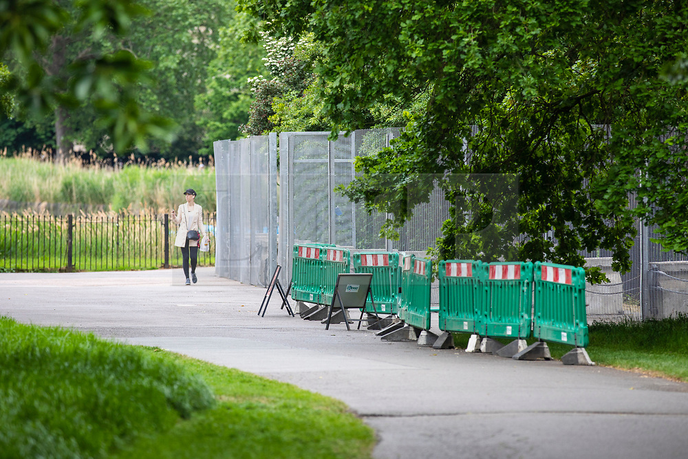 © Licensed to London News Pictures. 29/05/2019. London, UK. A woman walks past security fencing as it is installed around Winfield House, the US Ambassador's residence in central London, where President of the United States Donald Trump and his wife Melania Trump will host a dinner during their forthcoming State Visit to the United Kingdom. Photo credit: Rob Pinney/LNP