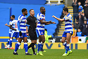 Yakou Meite (21) of Reading is congratulated by Nelson Oliveira (22) of Reading as he walks off to be substituted during the EFL Sky Bet Championship match between Reading and Brentford at the Madejski Stadium, Reading, England on 13 April 2019.