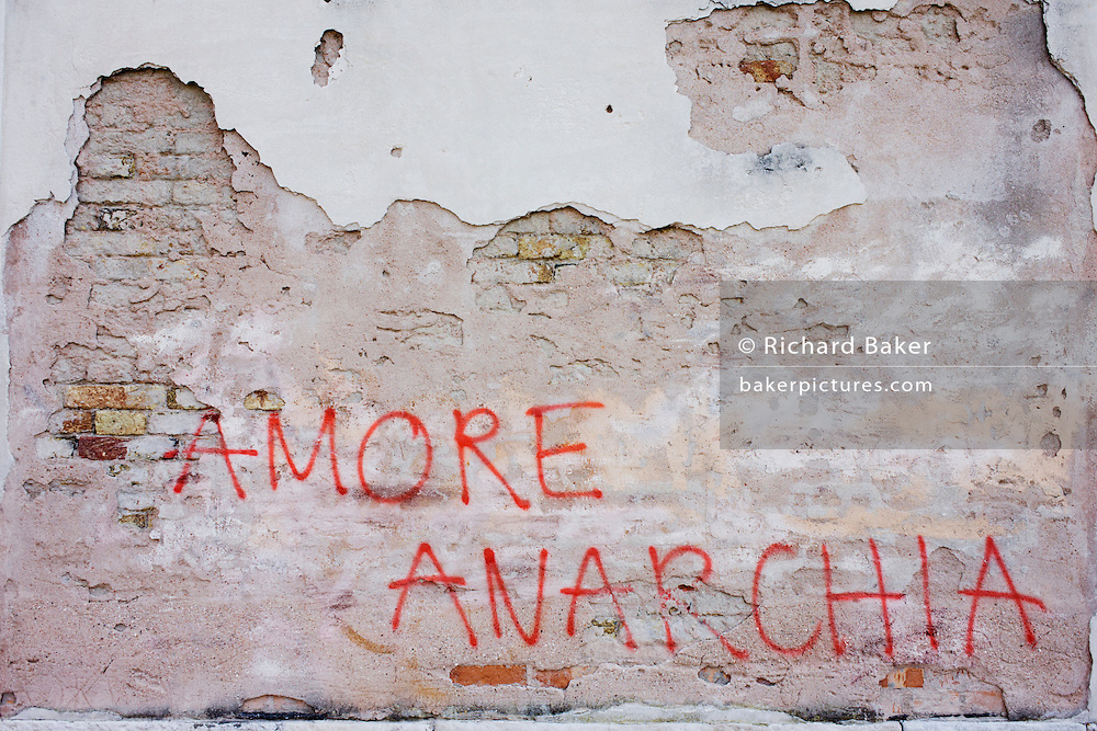 'Love Anarchy' graffiti on a wall on a wall on the Rio de San Margherita canal in Dorsoduro, a district of Venice, Italy.