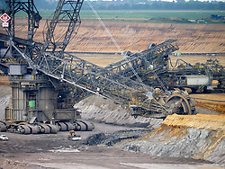 Large excavation machines working in RWE open-cast brown or lignite coal mine at Garzweiler in Northrhine Westfallia in Germany