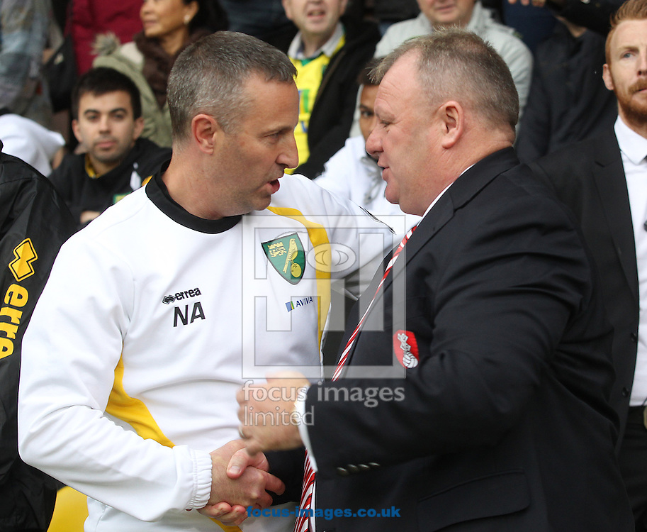 Norwich Manager Neil Adams and Rotherham United Manager Steve Evans before the Sky Bet Championship match at Carrow Road, Norwich<br /> Picture by Paul Chesterton/Focus Images Ltd +44 7904 640267<br /> 04/10/2014