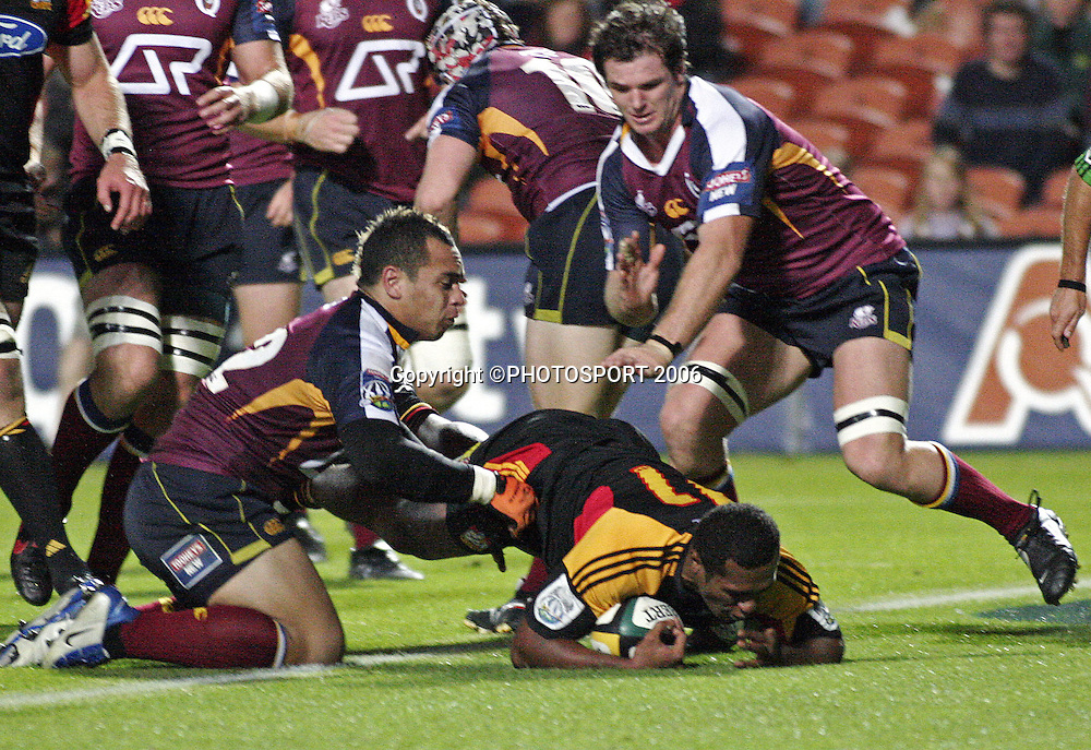 Chiefs wing Sitiveni Sivivatu dives in for a try during the Super 14 match between the Waikato Chiefs and Queensland Reds at Waikato Stadium, Hamilton on Friday 3 March 2006. The Chiefs won the game 35:17. Photo: Andy Song/PHOTOSPORT
