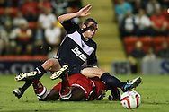 Picture by David Horn/Focus Images Ltd +44 7545 970036.21/08/2012.Midlfield battle during the npower League 1 match at the Matchroom Stadium, London.