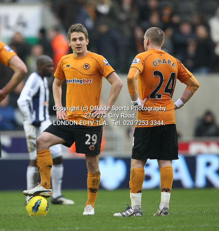 12/02/2012 Wolverhampton Wanderers v West Bromwich Albion.<br /> Kevin Doyle and Jamie O'Hara prepare to kick off after the fourth Albion goal.<br /> Photo: Mark Leech.