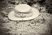 Lost Hat in the Sand at Playalinda Beach. Merritt Island, Florida. Image taken with a Nikon 700 camera and 28-300 mm VR lens (ISO 3200, 300 mm, f/5.6, 1/60 sec).