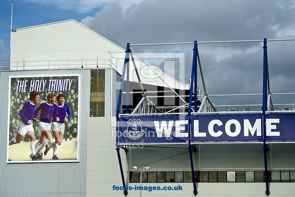 General view of the exterior of the stadium showing hoarding with a picture of former Everton players Coin Harvey, Alan Ball and Howard Kendall (known as 'The Holy Trinity') pictured ahead of the Barclays Premier League match at Goodison Park, Liverpool<br /> Picture by Ian Wadkins/Focus Images Ltd +44 7877 568959<br /> 18/10/2014
