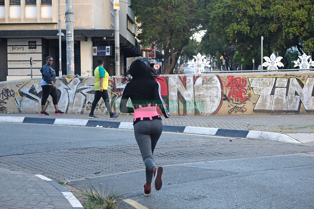 JOHANNESBURG, SOUTH AFRICA - MAY 10: A general view of people exercising in Braamfontein during lockdown level 4 on May 10, 2020 in Johannesburg, South Africa. According to media reports, during lockdown level 4 people are allowed to exercise. Guidelines allow for cycling, running and walking as examples and must be within a 5km radius of their residences between 6:00 am – 9:00 am. (Photo by Dino Lloyd)
