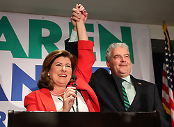 June 20, 2017 - Atlanta, Georgia, U.S. - Republican candidate KAREN HANDEL and her husband, STEVE, take the podium for her victory speech at her election night party in the 6th District race with Democrat Jon Ossoff.  Tuesday's runoff between Handel and Ossoff in Georgia's Sixth Congressional District was the most expensive House campaign in history. (Credit Image: © Curtis Compton/TNS via ZUMA Wire)