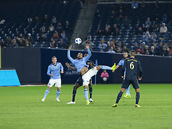 October 31, 2018 - New York, New York, United States - Yangel Herrera (30) of NYCFC & Cory Burke (19) of Philadelphia Union fight for ball during knockout round game at Yankees stadium NYCFC won 3 - 1 (Credit Image: © Lev Radin/Pacific Press via ZUMA Wire)
