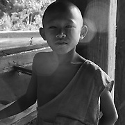 A novice monk on at a wat along the Ho Chi Minh Trail, Laos.