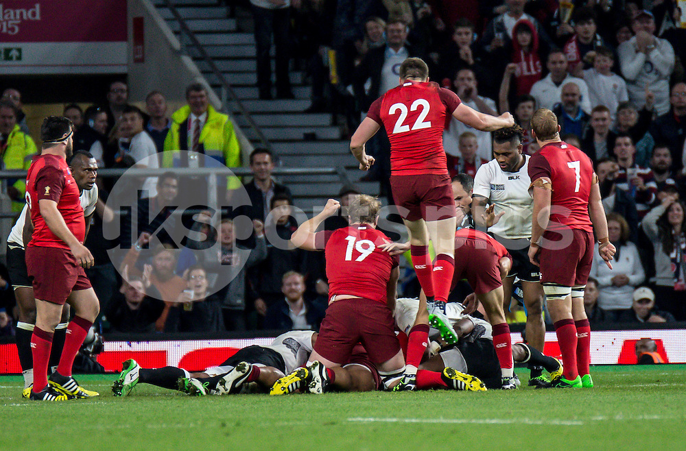Owen Farrell of England jumps for joy as Mike Brown of England goes over for his try during the Rugby World Cup 2015 Pool A match between England and Fiji played at Twickenham Stadium, London on 18 September 2015. Photo by Liam McAvoy.