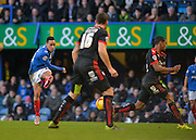Portsmouth midfielder Kyle Bennett with a shot at goal  during the Sky Bet League 2 match between Portsmouth and Crawley Town at Fratton Park, Portsmouth, England on 2 January 2016. Photo by Adam Rivers.