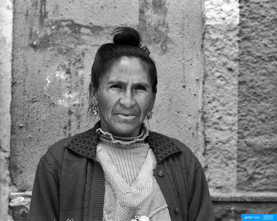Anarilma Escalante Vasquez, 45, Housewife. Potosi. Bolivia..Sitting at 4,090M (13,420 Feet) above sea level the small mining community of Potosi, Bolivia is one of the highest cities in the world by elevation and sits ?sky high? in the hills of the land locked nation. Overlooking the city is the infamous mountain, Cerro Rico (rich mountain), a mountain conceived to be made of silver ore. It was the major supplier of silver for the spanish empire and has been mined since 1546, according to records 45,000 tons of pure silver were mined from Cerro Rico between 1556 and 1783, 9000 tons of which went to the Spanish Monarchy. The mountain produced fabulous wealth and became one of the largest and wealthiest cities in Latin America. The Extraordinary riches of Potosi were featured in Maguel de Cervantes famous novel Don Quixote. One theory holds that the mint mark of Potosi, the letters PTSI superimposed on one another is the origin of the dollar sign. Today mainly zinc, lead, tin and small quantities of silver are extracted from the mine by over 100 co-operatives and private mining companies who still mine the mountain in poor working conditions, children are still used in the mines and the lack of protective equipment and constant inhalation of dust means miners have a short life expectancy with many contracting silicosis and dying around 40 years of age. UNESCO designated the historic city a World Heritage site in 1987. Most of Potosí's colonial churches have been restored, and tourism has increased. Potosi, Bolivia. 16th September 2011. Photo Tim Clayton