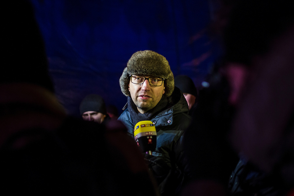 KIEV, UKRAINE - JANUARY 25: Arseniy Yatsenyuk, leader of the opposition Fatherland political party, talks with reporters after speaking to the crowd of anti-government protesters on Independence Square on January 25, 2014 in Kiev, Ukraine. After two months of primarily peaceful anti-government protests in the city center, new laws meant to end the protest movement have sparked violent clashes in recent days. (Photo by Brendan Hoffman/Getty Images) *** Local Caption *** Arseniy Yatsenyuk