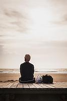 Dirk Kemp sits on the beach in Leca da Palmeira, Portugal.