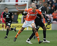 Blackpool - Saturday March 7th, 2009: Alex Baptiste of Blackpool and Carl Cort of Norwich City in action during the Coca Cola Championship match at Bloomfield Road, Blackpool. (Pic by Michael Sedgwick/Focus Images)