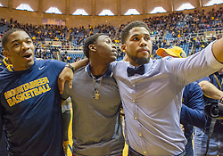 West Virginia senior guards Tyrone Hughes (left), Juwan Staten (center) and Gary Browne (right) walk off the floor together after beating Oklahoma State at the WVU Coliseum.