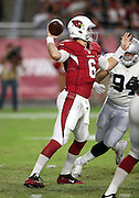 Arizona Cardinals rookie quarterback Jake Coker (6) throws a pass while being pressured by Oakland Raiders rookie defensive end Greg Townsend Jr. (94) during the 2016 NFL preseason football game against the Oakland Raiders on Friday, Aug. 12, 2016 in Glendale, Ariz. The Raiders won the game 31-10. (©Paul Anthony Spinelli)