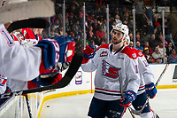 KELOWNA, BC - SEPTEMBER 21:  Michael King #19 of the Spokane Chiefs celebrates a goal with fist bumps past the bench against the Kelowna Rockets  at Prospera Place on September 21, 2019 in Kelowna, Canada. (Photo by Marissa Baecker/Shoot the Breeze)