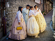 "SEOUL, SOUTH KOREA: Tourists wearing traditional Korean ""Hanbok"" clothing, walk around and take selfies in the Bukchon Hanok village in Seoul. Hanok is the traditional style of construction in South Korea and Bukchon is one of the only remaining Hanok communities in Seoul. It is close to Gyeongbokgung Palace and popular with tourists.      PHOTO BY JACK KURTZ"