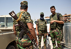 © Licensed to London News Pictures. 29/06/2014. Khanaqin, UK Khanaqin, Iraq. Kurdish peshmerga fighters prepare to head out and relieve troops at the front line in Jalawla at a Kurdish peshmerga base in Khanaqin, Iraq. Counted by Kurds as part of their homeland, fighting in the town of Jalawla now consists of occasional skirmishes and exchanges of fire between snipers and heavy machine guns on both sides.<br /> <br /> The peshmerga, roughly translated as those who fight, is at present engaged in fighting ISIS all along the borders of the relatively safe semi-automatous province of Iraqi-Kurdistan. Though a well organised and experienced fighting force they are currently facing ISIS insurgents armed with superior armament taken from the Iraqi Army after they retreated on several fronts. Photo credit : Matt Cetti-Roberts/LNP