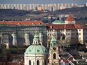 Im Vordergrund Turm und Kuppel der St. Niklas Kirche am Kleinseitner Ring (Malostranske Namesti) - im Hintergrund Plattenbauten. <br /> <br /> <br /> Prague urban landscape - in front parts of the St. Nicholas church at Malostranska square (Malostranske Namesti) - in the back panel houses.