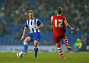 Brighton and Hove Albion Women's midfielder Jay Blackie takes on Charlton Athletic Ladies player Nikita Whinnett during the FA Women's Premier League match between Brighton Ladies and Charlton Athletic WFC at the American Express Community Stadium, Brighton and Hove, England on 6 December 2015.