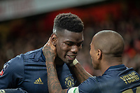 Football - 2018 / 2019 FA Cup - Fourth Round: Arsenal vs. Manchester United <br /> <br /> Ashley Young (Manchester United) congratulates Paul Pogba (Manchester United) for his assist in the teams third goal at The Emirates Stadium.<br /> <br /> COLORSPORT/DANIEL BEARHAM