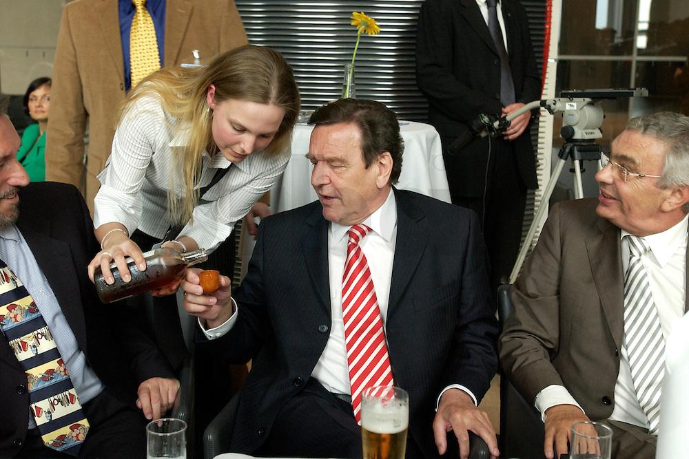 27 APR 2004, BERLIN/GERMANY:<br /> Gerhard Schroeder (L), SPD, Bundeskanzler, und Jann-Peter Janssen (R), MdB, SPD, aus dem ostfriesischen Wahlkreis Aurich-Emden, trinken noch einen Schnaps Marke &quot;Grootheider Bittern&quot;, waehrend dem Eroeffnungsabend der 1. kulinarischen Ostfriesland-Woche, Abgeordneten-Restaurant des Deutschen Bundestages, Rechstagsgebaeude<br /> IMAGE: 20040427-04-024<br /> KEYWORDS: Gerhard Schr&ouml;der, Regional-Marketing Norderfleisch, Parlamentarischer Abend, Alkohol, Getr&auml;nk, Getraenk
