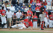 Mississippi's Sikes Orvis (24) scores behind Texas Tech's Hunter Redman (5) at T.D. Ameritrade Park in the College World Series in Omaha, Neb. on Tuesday, June 17, 2014. Ole Miss won 2-1.