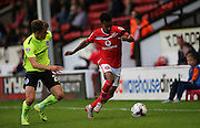 Walsall defender, Rico Henry goes past Brighton striker, Solomon March during the Capital One Cup match between Walsall and Brighton and Hove Albion at the Banks's Stadium, Walsall, England on 25 August 2015.