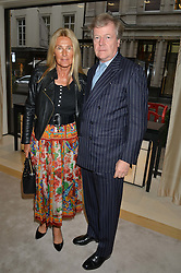 The HON.CHARLES & MRS PEARSON  at the draw for the Jaeger-LeCoultre Gold Cup held at Jaeger-LeCoultre, 13 Old Bond Street, London on 8th June 2015.