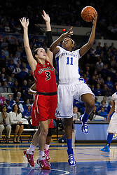 UK center DeNesha Stallworth, right shoots a hook shot over Georgia guard/forward Anne Marie Armstrong in the first half. The University of Kentucky Women's Basketball team hosted Georgia, Sunday, Feb. 03, 2013 at Memorial Coliseum in Lexington.