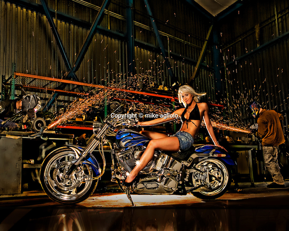 woman on motor cycle in shop